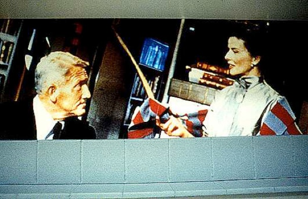 Details. The video monitor is embedded in the book case between Spencer Tracy (L) and Katharine Hepburn (R), here seen in a scene from the movie